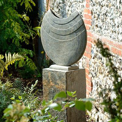 Ikra natural slate sculpture with surmi plinth