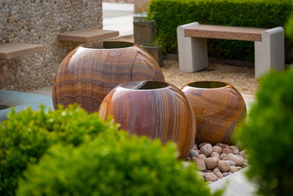 trio of stone sphere planters