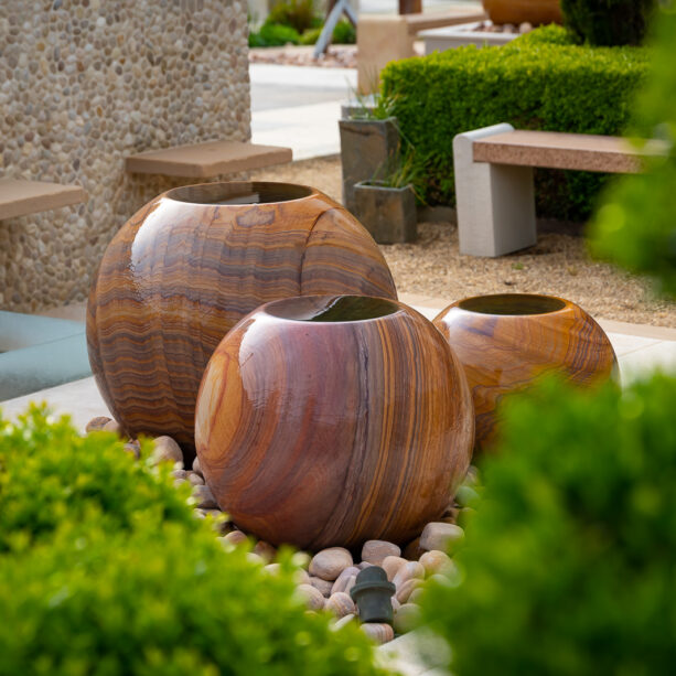 trio of stone sphere planters