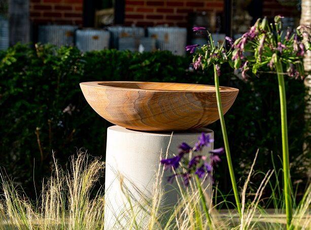 stone bird bath on plinth