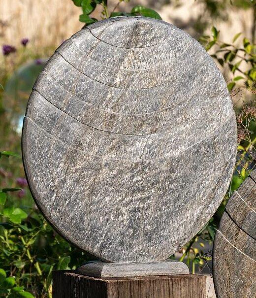 Caviara sculpture on oak plinth